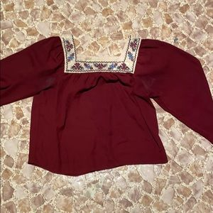 Maroon colored blouse